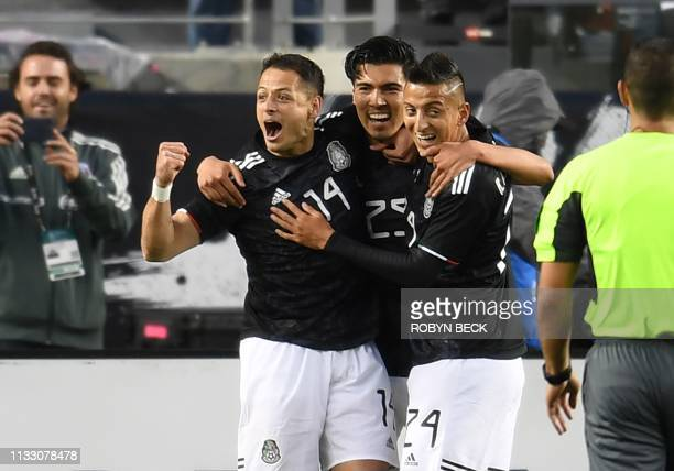 Mexico's Javier Hernandez celebrates with teammates after scoring a goal during the international friendly match between Mexico and Paraguay at...
