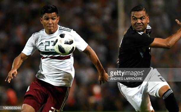 Mexico's Jesus Gallardo vies for the ball with Argentina's Gabriel Mercado during their friendly football match at Malvinas Argentinas stadium in...