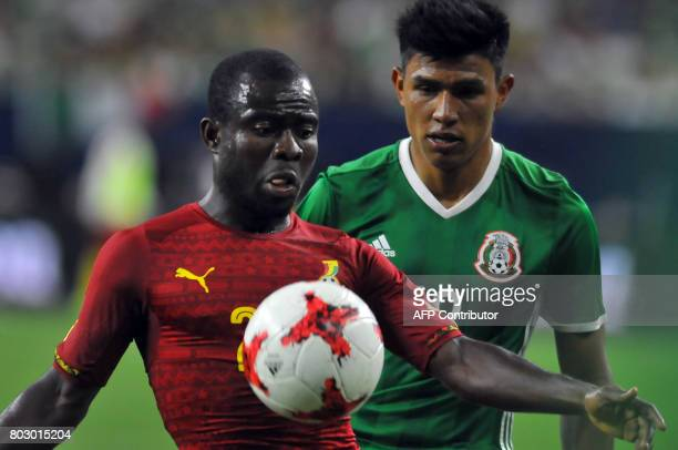 Mexico's Jesus Gallardo vies for the ball with Ghana's Frank Acheampong during the friendly match between Mexico and Ghana at NRG stadium on June 28...