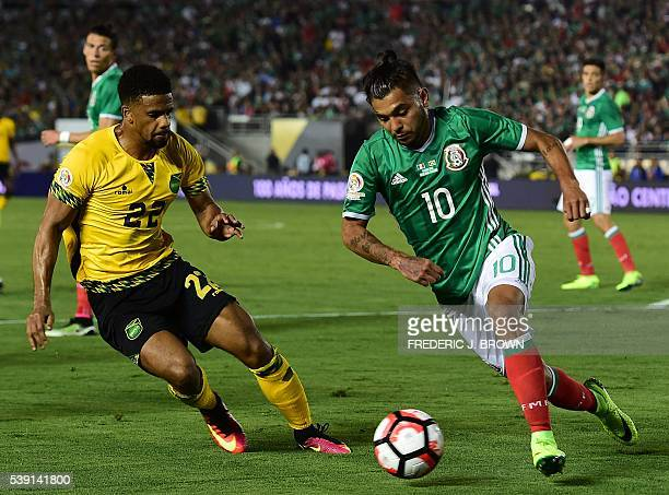 Mexico's Jesus Manuel Corona and Jamaica's Garath McCleary during the Copa America Centenario football match in Pasadena California United States on...