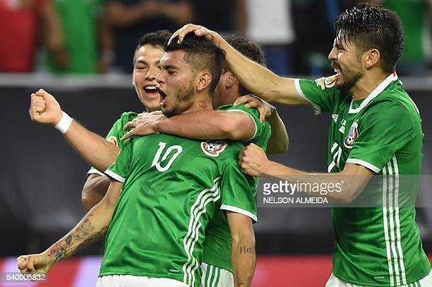 TOPSHOT Mexico's Jesus Manuel Corona celebrates with teammates after scoring against Venezuela during their Copa America Centenario football...