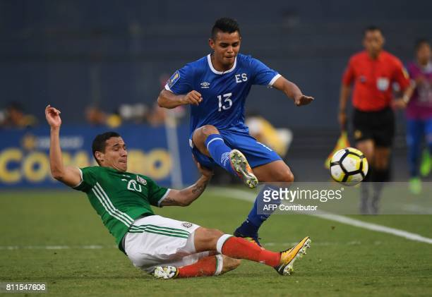 Mexico's Jeusus Duenas challenges El Salvador's Alexander Larin during Group C play in the 2017 CONCACAF Gold Cup July 9 2017 at Qualcomm Stadium in...