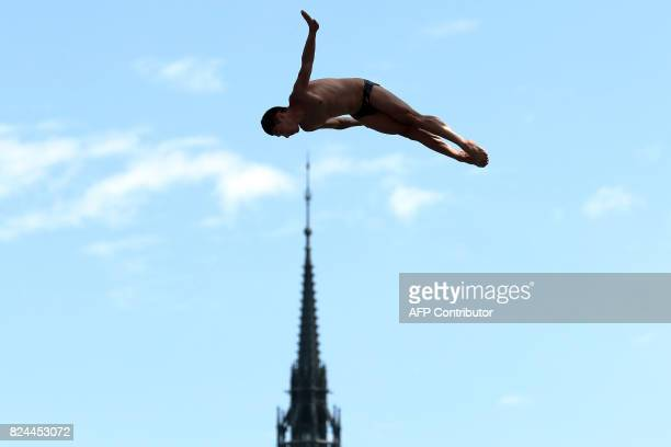 TOPSHOT Mexico's Jonathan Parades competes in round 3 of the men's High Diving competition at the 2017 FINA World Championships in Budapest on July...