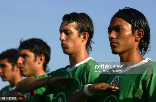 Mexico's Jose Luis Mendoza lines up with his team mates to sing the national anthym