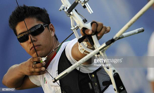Mexico's Juan Rene Serrano competes in the men's individual archery quarterfinal during the 2008 Beijing Olympic Games at the Capital Gymnasium in...