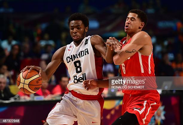 Mexico´s Juan Toscano vies for the ball with Andrew Wiggins of Canada during their 2015 FIBA Americas Championship Men's Olympic qualifying match at...