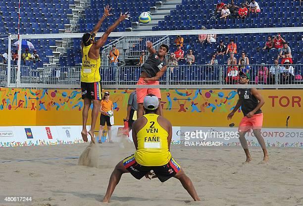 Mexico's Juan Virgen looks on as Rodolfo Ontiveres smashes the ball at Venezuela's Jackson Henriquez and Jesus VillaFane during the Men's Beach...