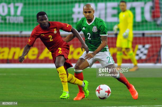 Mexico's Luis Rodriguez vies for the ball with Ghana's Thomas Agyepong during the friendly match between Mexico and Ghana at NRG stadium on June 28...