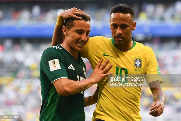 Mexico's midfielder Andres Guardado and Brazil's forward Neymar speak together during the Russia 2018 World Cup round of 16 football match between...