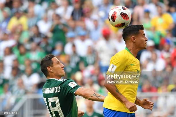 Mexico's midfielder Andres Guardado and Brazil's forward Philippe Coutinho vie for the ball during the Russia 2018 World Cup round of 16 football...