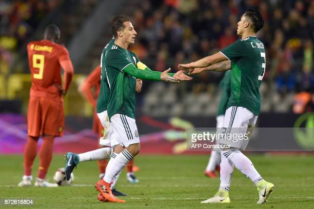 Mexico's midfielder Andres Guardado celebrates after scoring a goal during the international friendly football match between Belgium and Mexico at...