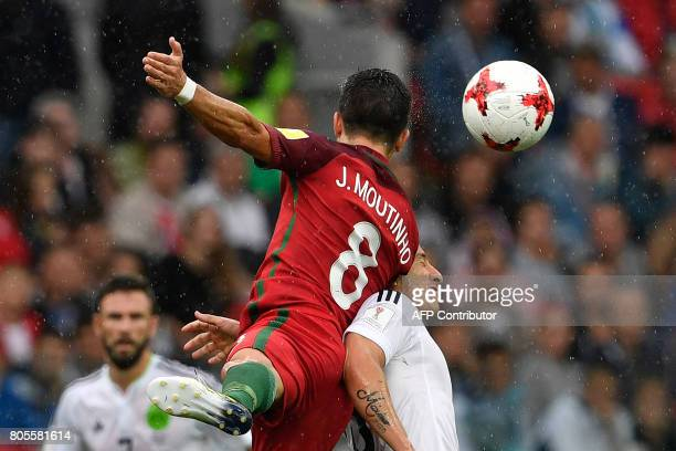 TOPSHOT Mexico's midfielder Andres Guardado heads the ball with Portugal's midfielder Joao Moutinho during the 2017 FIFA Confederations Cup third...