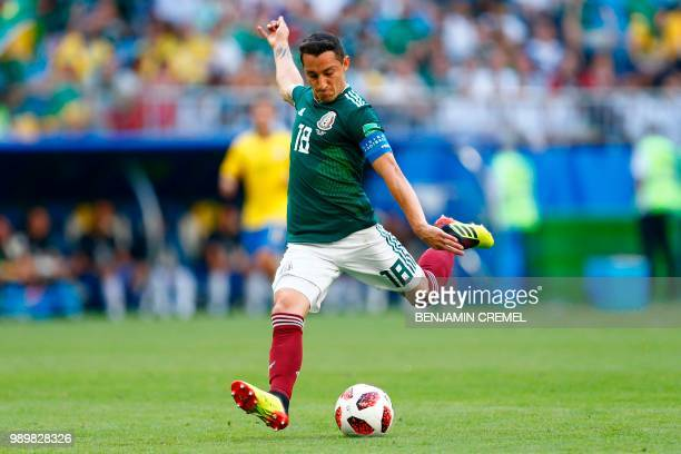 Mexico's midfielder Andres Guardado kicks the ball during the Russia 2018 World Cup round of 16 football match between Brazil and Mexico at the...