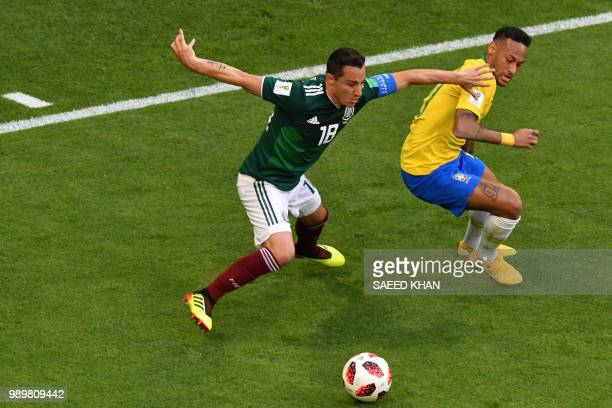 Mexico's midfielder Andres Guardado vies for the ball with Brazil's forward Neymar during the Russia 2018 World Cup round of 16 football match...