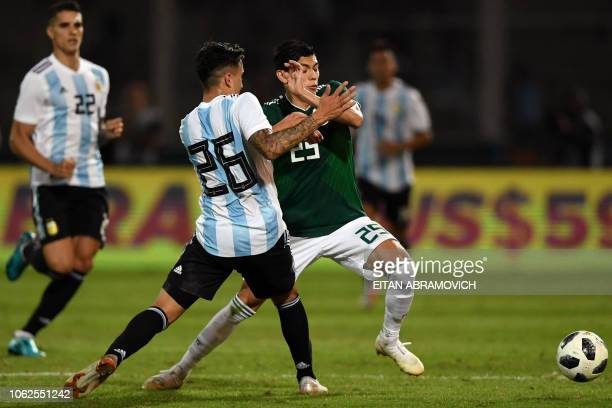 Mexico's midfielder Franco Vazquez vies for the ball with Argentina's defender Renzo Saravia during their friendly football match at Mario Alberto...