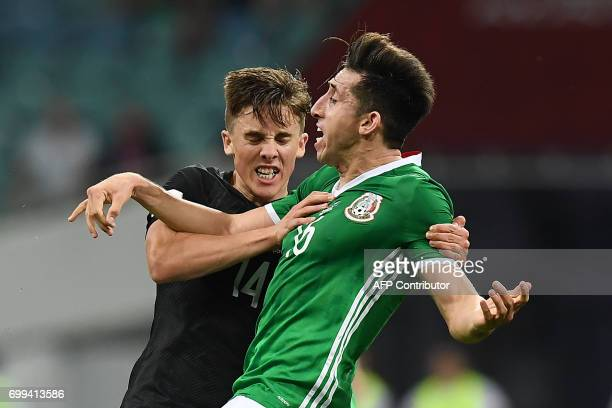 Mexico's midfielder Hector Herrera and New Zealand's midfielder Ryan Thomas fight during the 2017 Confederations Cup group A football match between...