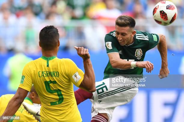 Mexico's midfielder Hector Herrera vies for the ball with Brazil's midfielder Casemiro during the Russia 2018 World Cup round of 16 football match...
