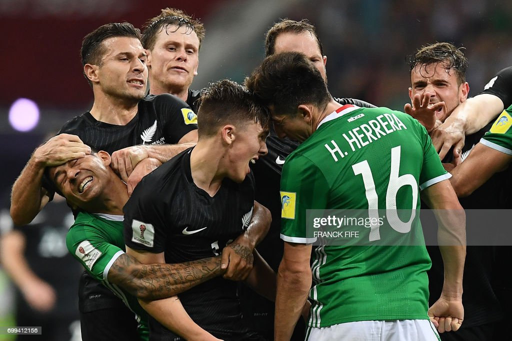 Mexico's midfielder Javier Aquino (L) and Mexico's midfielder Hector Herrera (R) fight with New Zealand's midfielder Ryan Thomas (C) and New Zealand's forward Kosta Barbarouses (L) during the 2017 Confederations Cup group A football match between Mexico and New Zealand at the Fisht Stadium in Sochi on June 21, 2017. /