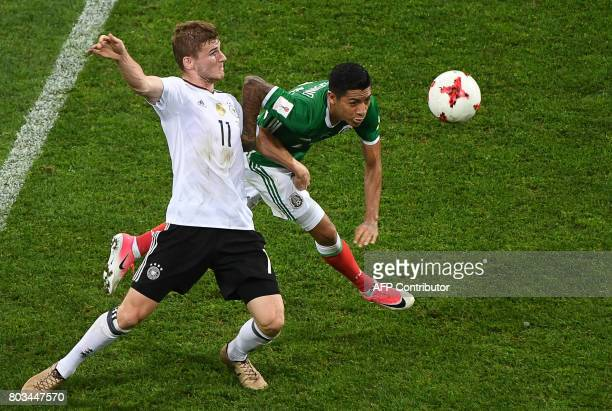 Mexico's midfielder Javier Aquino challenges Germany's forward Timo Werner during the 2017 FIFA Confederations Cup semifinal football match between...