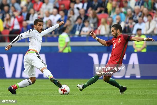 TOPSHOT Mexico's midfielder Jonathan Dos Santos vies with Portugal's midfielder Joao Moutinho during the 2017 Confederations Cup group A football...