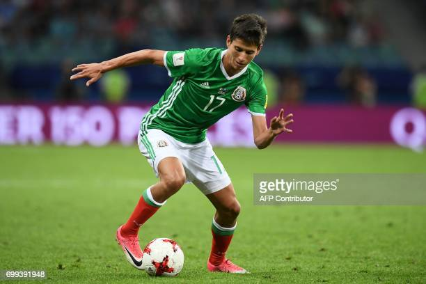 Mexico's midfielder Juergen Damm runs with the ball during the 2017 Confederations Cup group A football match between Mexico and New Zealand at the...