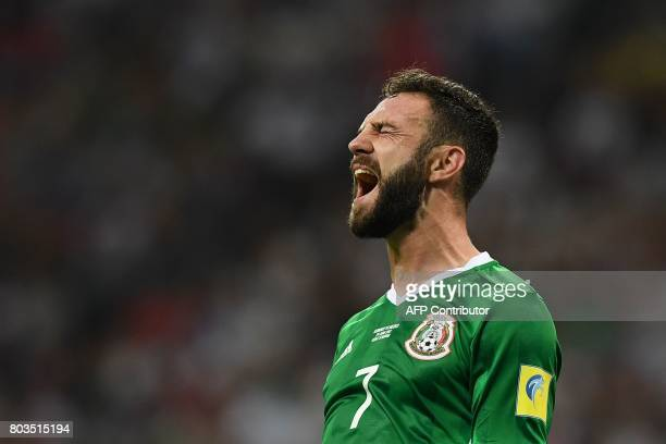 Mexico's midfielder Miguel Layun reacts after missing a goal opportunity during the 2017 FIFA Confederations Cup semifinal football match between...