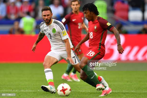 Mexico's midfielder Miguel Layun vies with Portugal's forward Gelson Martins during the 2017 Confederations Cup group A football match between...