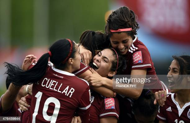 Mexico's midfielder Veronica Perez is congratulated by teammates after scoring a goal during a Group F match at the 2015 FIFA Women's World Cup...