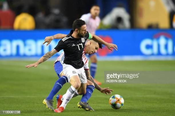 Mexico's Miguel Layun fights for the ball with Paraguay's Angel Romero during the international friendly match between Mexico and Paraguay at Levi's...