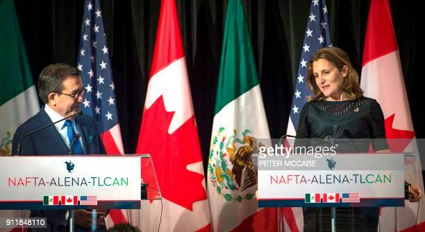 Mexico's Minister of Economy Ildefonso Guajardo looks on as Canadian Foreign Affairs minister Chrystia Freeland speaks to the press at the closing of...