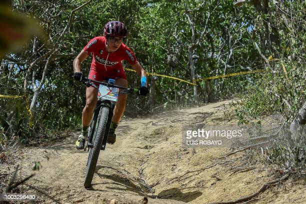 Mexico's Monica Vega competes in the Women's Mountain Bike Cross Country finals event of the cyclying competition of the 2018 Central American and...