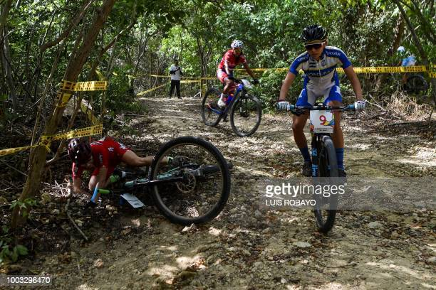 Mexico's Monica Vega falls during the Women's Mountain Bike Cross Country finals event of the cyclying competition of the 2018 Central American and...