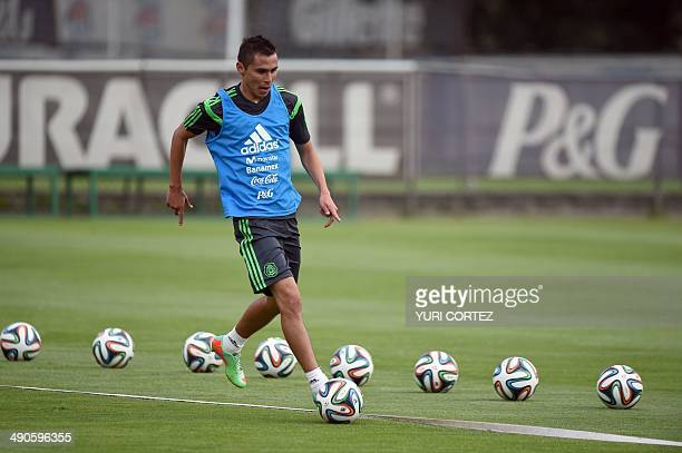 Mexico's national football team defender Paul Aguilar drives the ball during a training session at the High Perfomance Center in Mexico City on May...