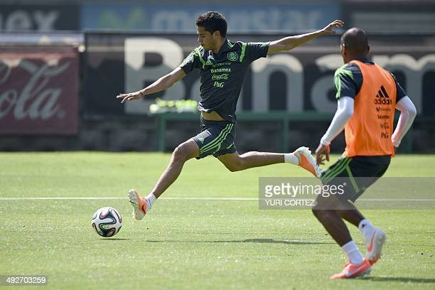 Mexico's national football team defenders Diego Reyes and Carlos Salcido during a training session at the High Performace Center in Mexico City on...
