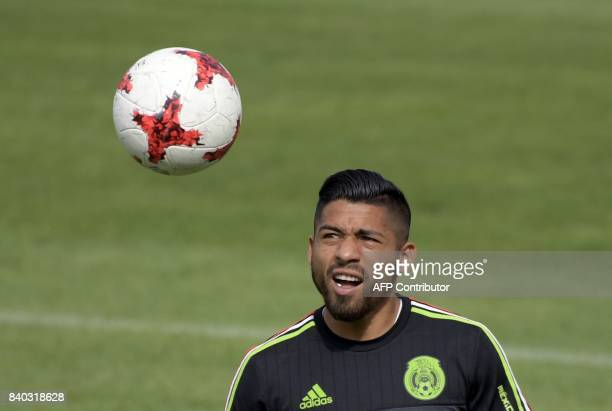 Mexico's national football team forward Aquino takes part in a training session ahead of their World Cup qualifier against Panama at the Centenario...