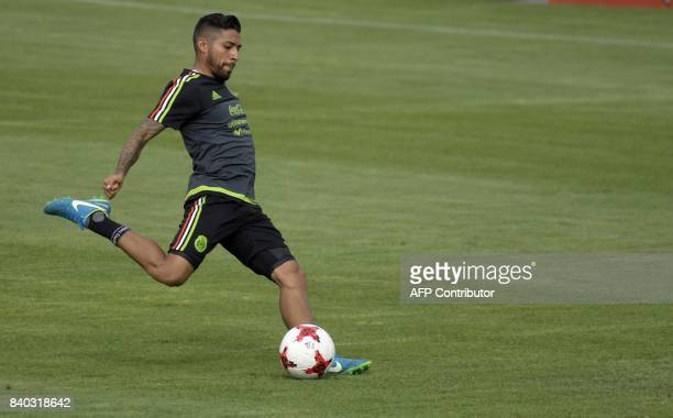 Mexico's national football team forward Javier Aquino takes part in a training session ahead of their World Cup qualifier against Panama at the...