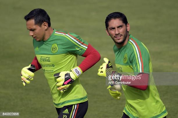 Mexico's national football team goalkeepers Rodolfo Cota and Jesus Corona take part in a training session ahead of their World Cup qualifier against...