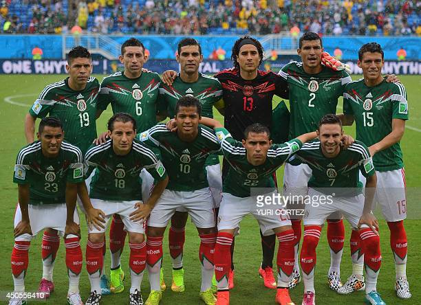 Mexico's national football team players forward Oribe Peralta midfielder Hector Herrera defender and captain Rafael Marquez goalkeeper Guillermo...