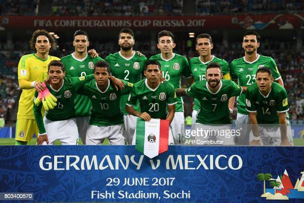 Mexico's national football team players goalkeeper Guillermo Ochoa forward Raul Jimenez defender Nestor Araujo midfielder Hector Herrera defender...