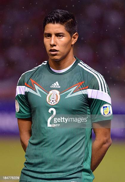 Mexico's national footballer Hugo Ayala listens to the national anthems before the start of the Brazil 2014 FIFA World Cup Concacaf qualifier match...