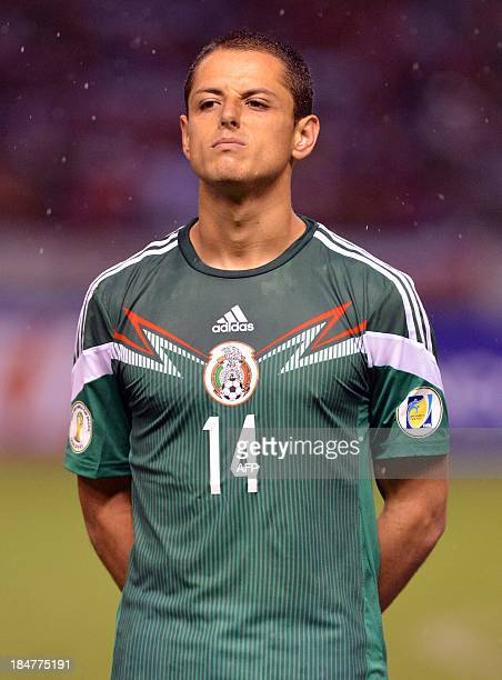 Mexico's national footballer Javier Hernandez listens to the national anthems before the start of the Brazil 2014 FIFA World Cup Concacaf qualifier...