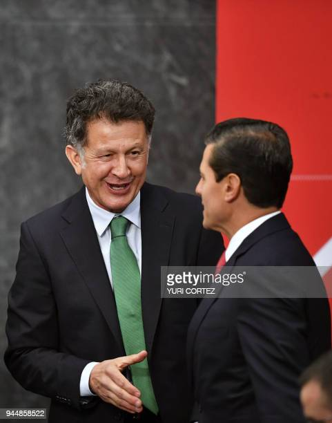 Mexico's national team football coach Colombian Juan Carlos Osorio greets Mexican President Enrique Pena Nieto during the FIFA World Cup trophy...