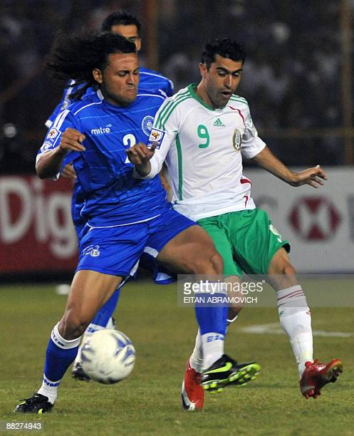 Mexico's Nery Castillo vies for the ball with El Salvador's Alexander Escobar during their FIFA World Cup South Africa2010 qualifier football match...