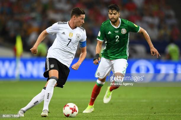 Mexico's Nestor Araujo and Germany's Julian Draxler during match the FIFA Confederations Cup 2017 between Germany and Mexico in Sochi Russia on June...