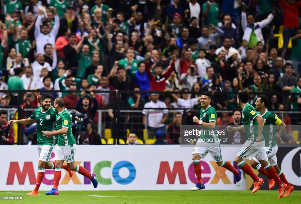 Mexico's Nestor Araujo (L) celebrates his goal against Costa Rica with Mexico's forward Javier Hernandez (2-L) during their 2018 FIFA World Cup qualifier football match in Mexico City on March 24, 2017. /