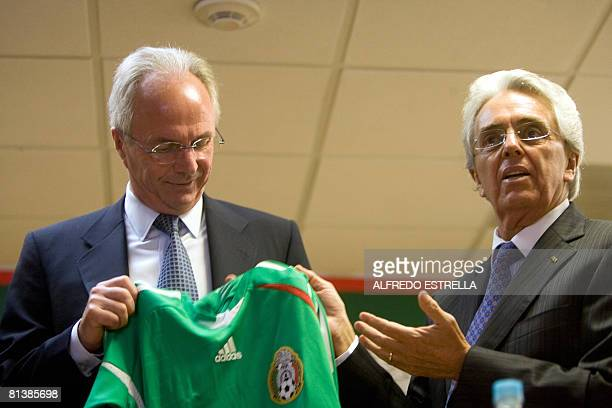 Mexico's new national football team coach Swedish SvenGoran Eriksson shows Mexico's shirt alongside Justino Compean President of the Mexican Football...