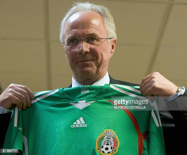 Mexico's new national football team coach Swedish SvenGoran Eriksson shows Mexico's shirt during a press conference in Mexico City on June 3 2008...