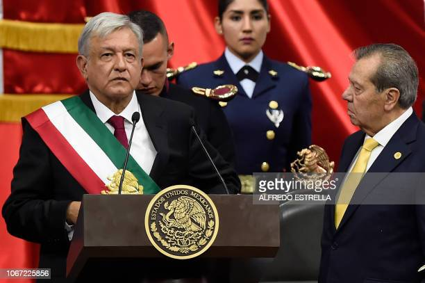 Mexico's new President Andres Manuel Lopez Obrador gets ready to deliver a speech next to the President of the Congress Porfirio Munoz Ledo during...