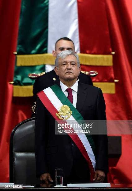 Mexico's new President Andres Manuel Lopez Obrador stands receiving the presidential sash during the inauguration ceremony at the Congress of the...