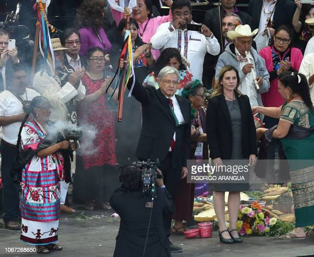 Mexico's new President Andres Manuel Lopez Obrador takes part in a ceremony in which he received a ceremonial staff from indigenous people, next to...